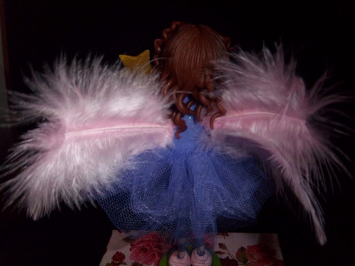 haditas patas largas, porcelana fria, tul y plumas
