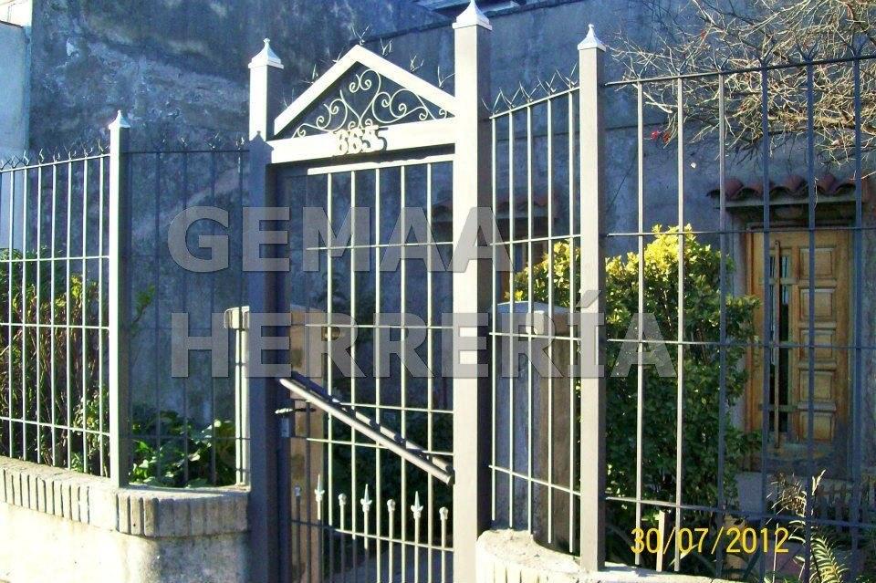 Puertas de hierro rejas para frentes inviolables 8 for Rejas de hierro precios